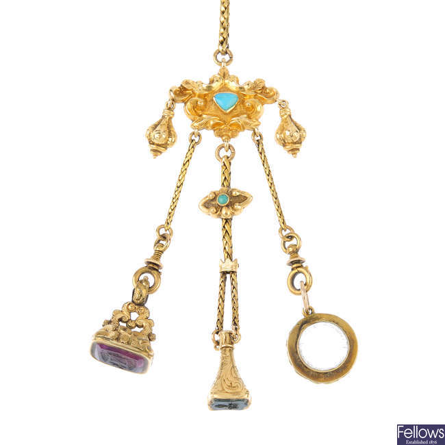 A late 19th century gold gem-set chatelaine and fobs.