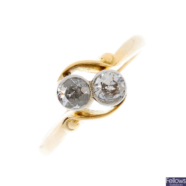 An early 20th century 18ct gold diamond two-stone crossover ring.