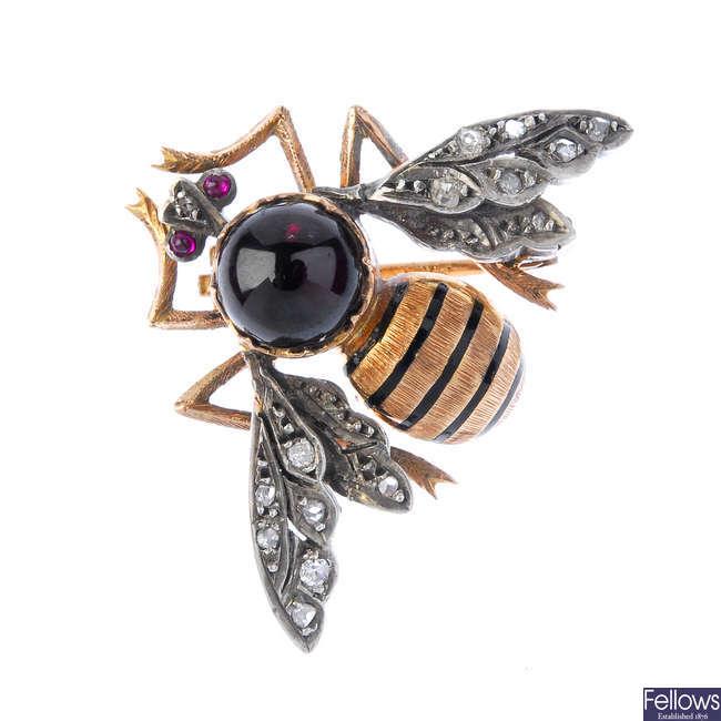 A gem and enamel bee brooch.