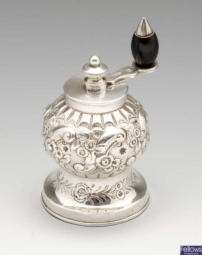 A late Victorian silver pepper grinder.