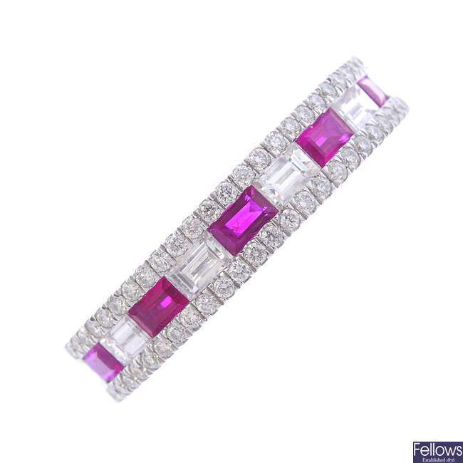 An 18ct gold ruby and diamond half-circle eternity ring