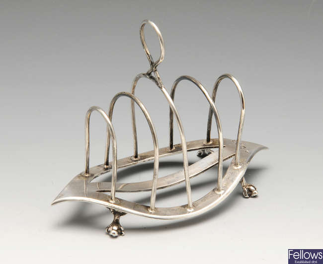 A late Victorian silver toast rack, etc.