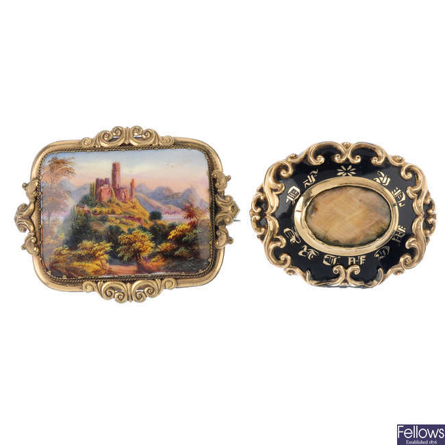 A ceramic brooch and a late 19th century memorial brooch.