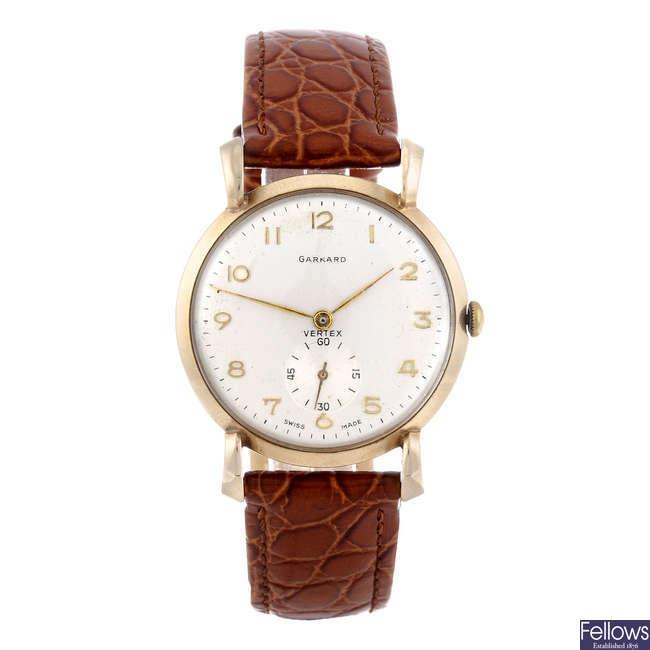 GARRARD - a gentleman's 9ct yellow gold wrist watch.