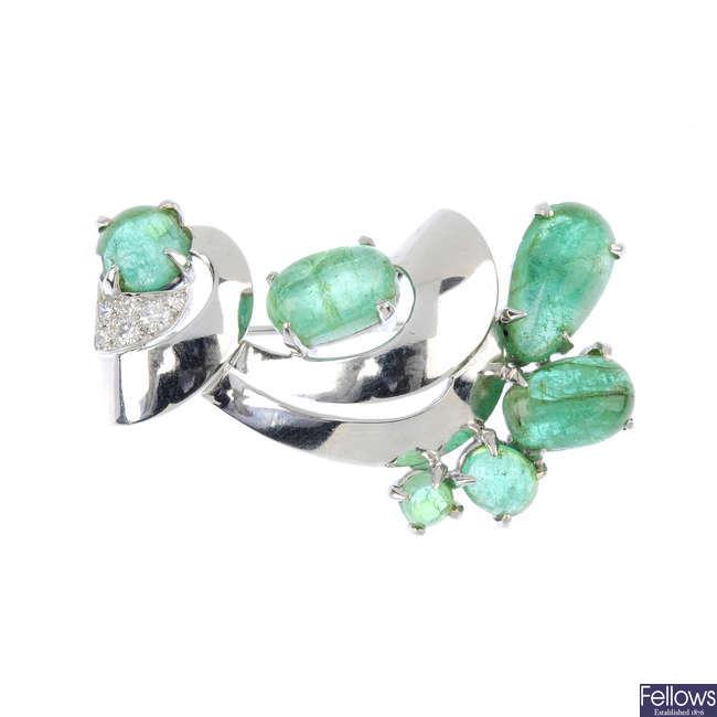 An emerald and diamond spray brooch.