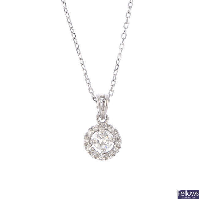 A platinum diamond cluster pendant, with chain.