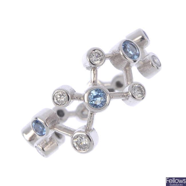An 18ct gold diamond and aquamarine dress ring.