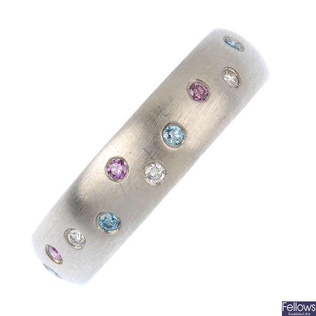 A platinum diamond and colour treated diamond band ring.