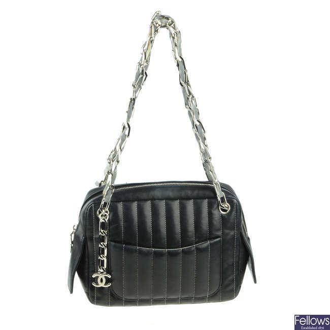 CHANEL - a small quilted Mademoiselle Camera handbag.