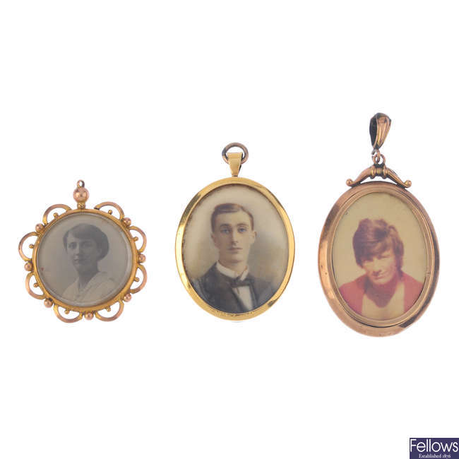 Three late 19th to early 20th century gold photograph pendants.