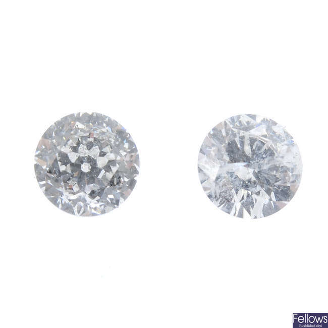 Two brilliant-cut diamonds, weighing 0.27 and 0.23ct.