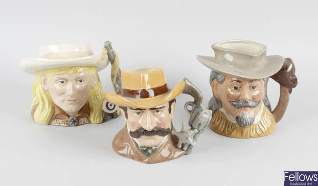 A group of American-themed Royal Doulton character jugs