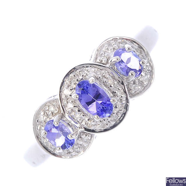 A 9ct gold tanzanite triple cluster ring.