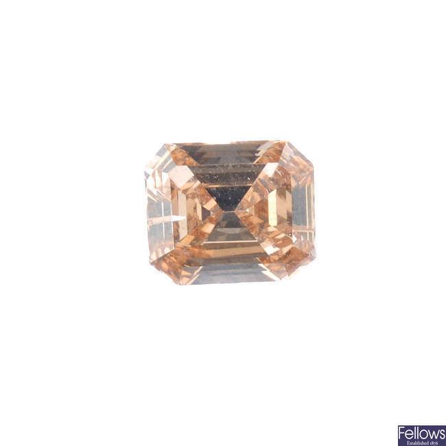 A rectangular-shape 'brown' diamond, weighing 0.59ct.