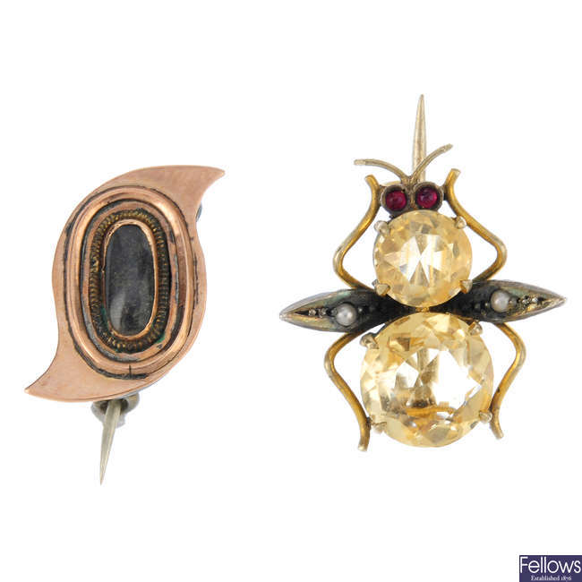 A mid Victorian memorial brooch and an early 20th century brooch.