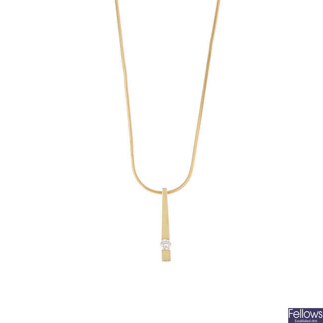 A 18ct gold diamond pendant and chain.