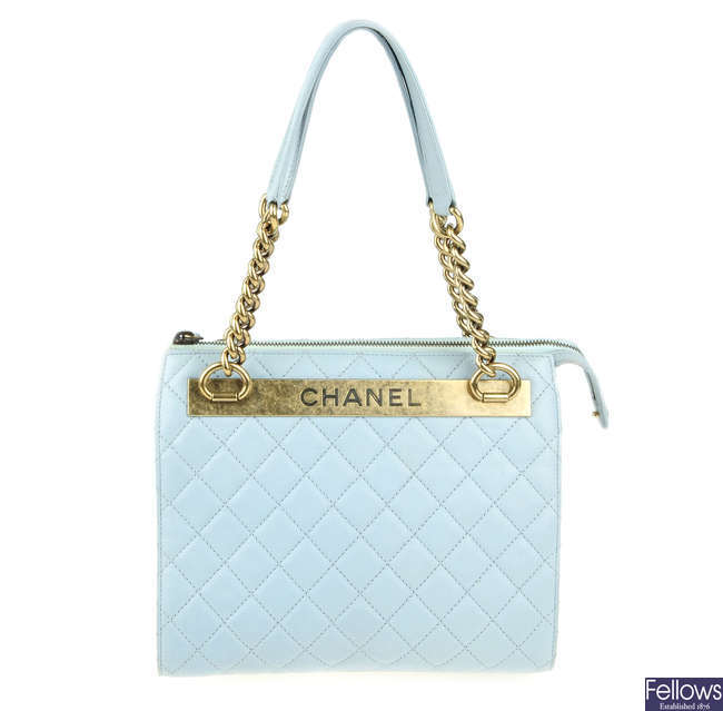 CHANEL - a quilted leather handbag.
