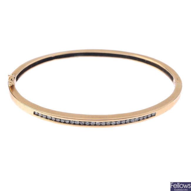 A 9ct gold diamond hinged bangle.