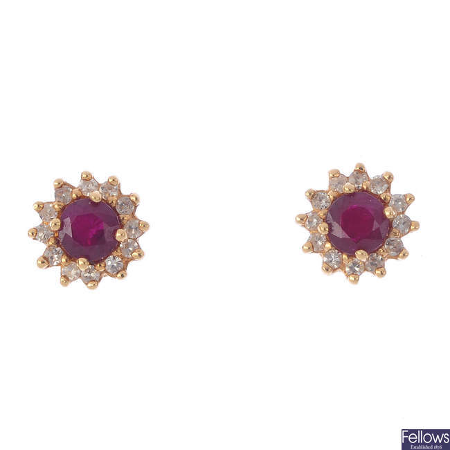 A pair of diamond and ruby cluster stud earrings.
