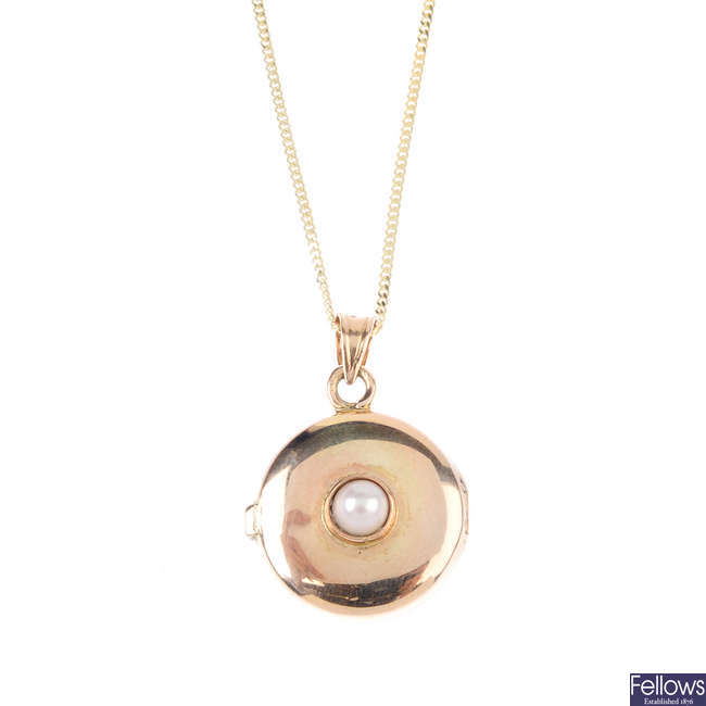 A 9ct gold split pearl and ruby locket, with chain.