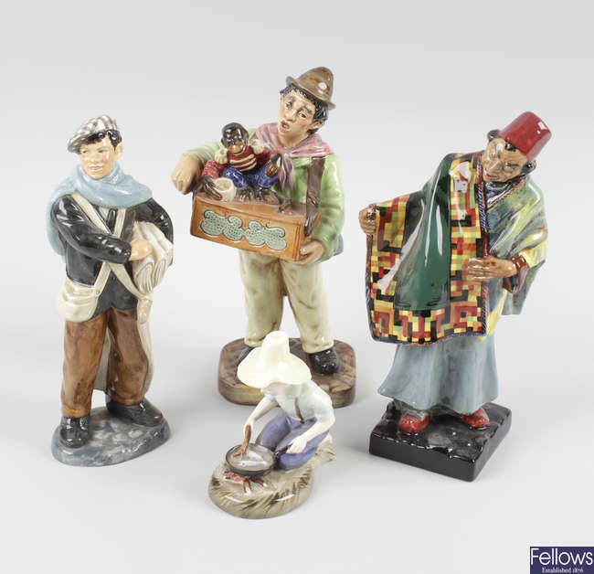 A group of Royal Doulton figures.