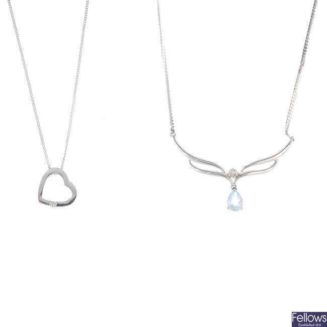 Five diamond and gem-set pendants with chains.