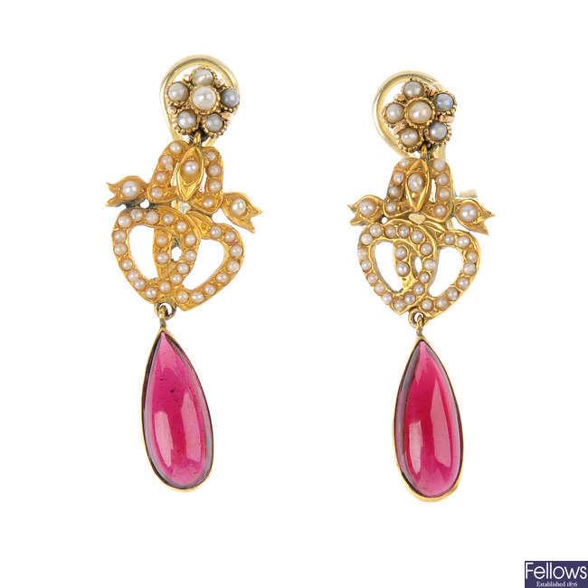 A pair of garnet and split pearl earrings.