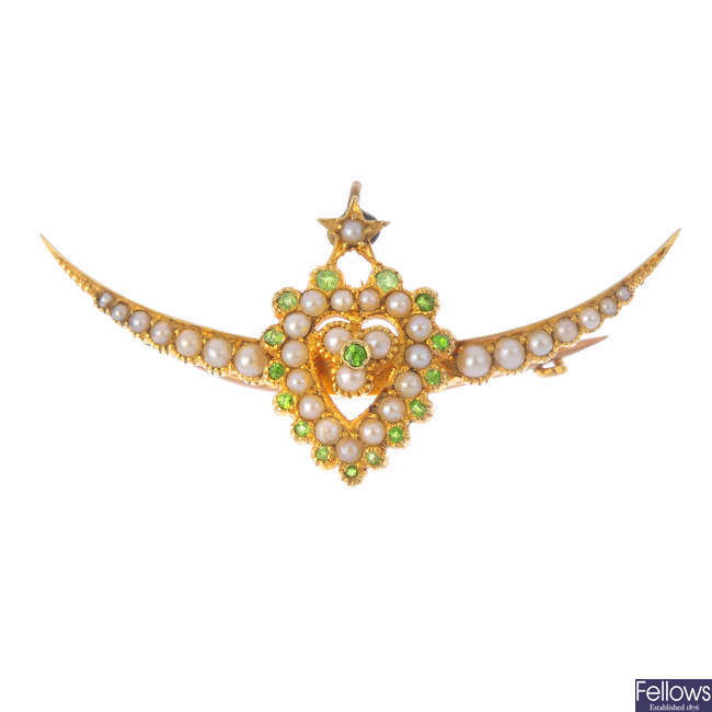 An Edwardian 15ct gold demantiod garnet and seed pearl heart and crescent brooch.