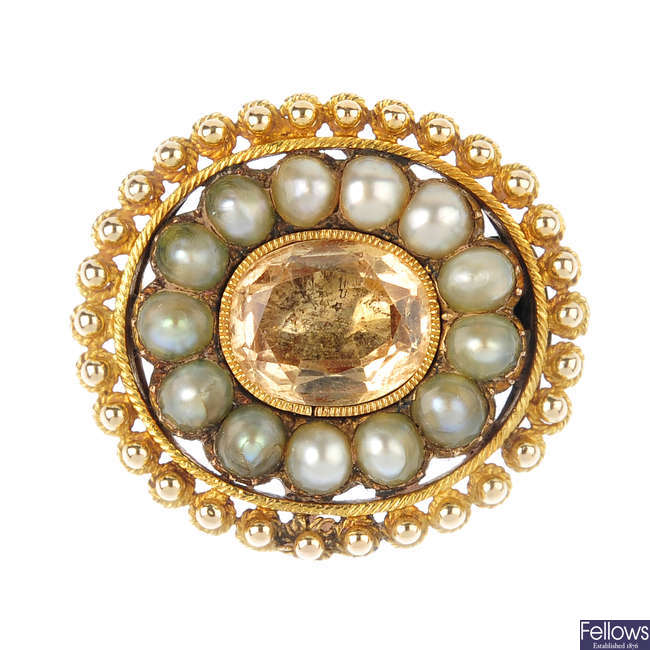 A mid Victorian gold foil-back topaz and split pearl cluster brooch, circa 1850.