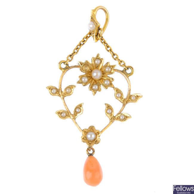 An early 20th century gold coral and seed pearl pendant.