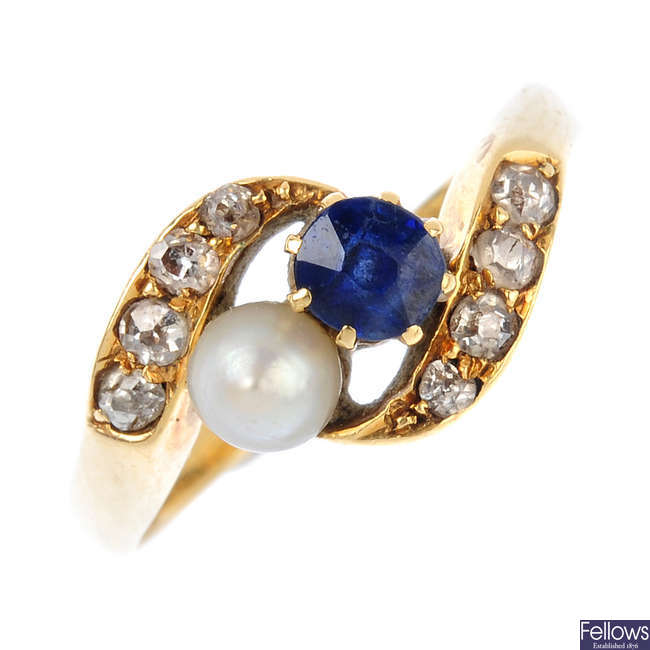 An Edwardian 18ct gold sapphire, pearl and diamond crossover ring.