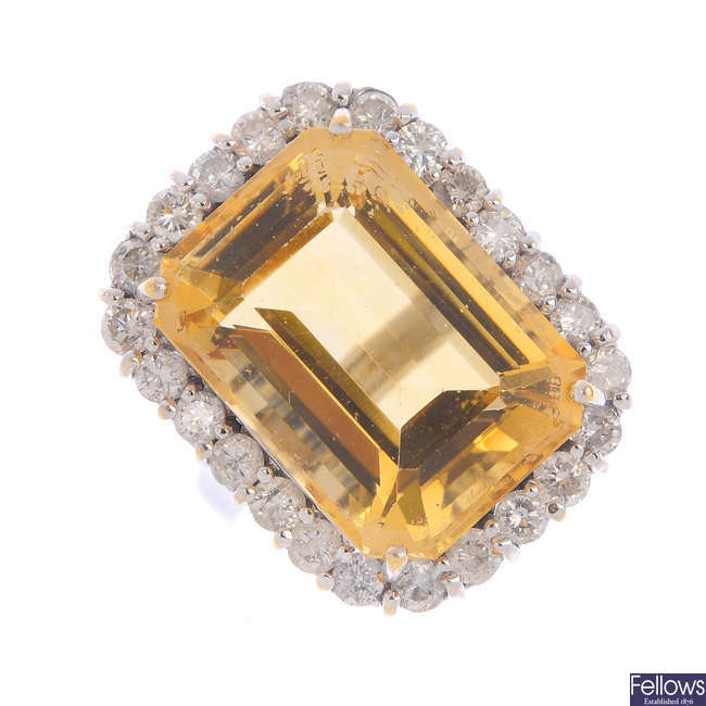 A citrine, diamond and synthetic moissanite cluster ring.