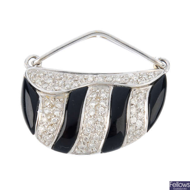A diamond and onyx pendant.