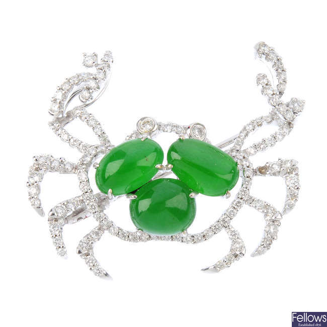 A diamond and jade crab brooch.