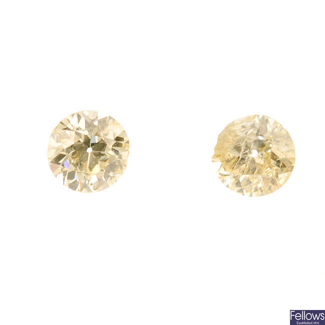 Two brilliant-cut diamonds, weighing 0.63 and 0.60ct.