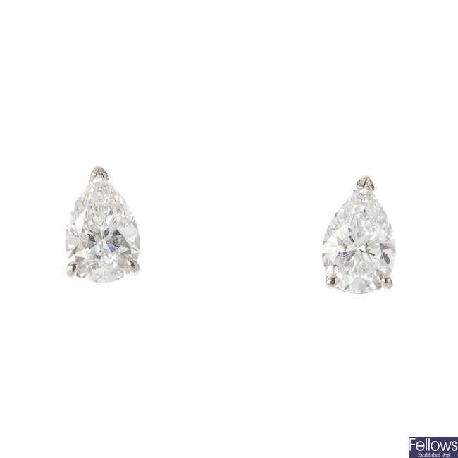 A pair of pear-shape diamond ear studs.