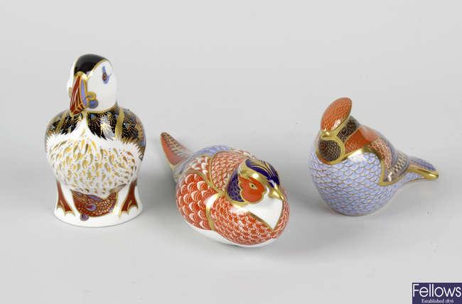 Three Crown Derby bone china studied of birds.