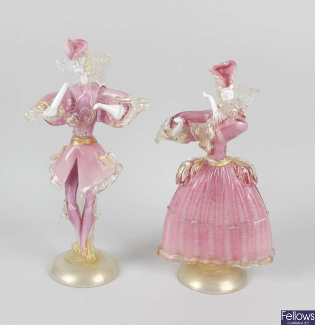 A pair of Murano pink and white mottle glass figures.