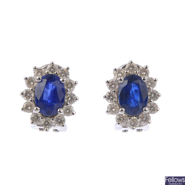 A pair of sapphire and diamond cluster earrings.
