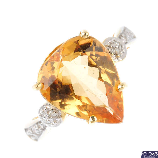An 18ct gold andalusite and diamond ring.