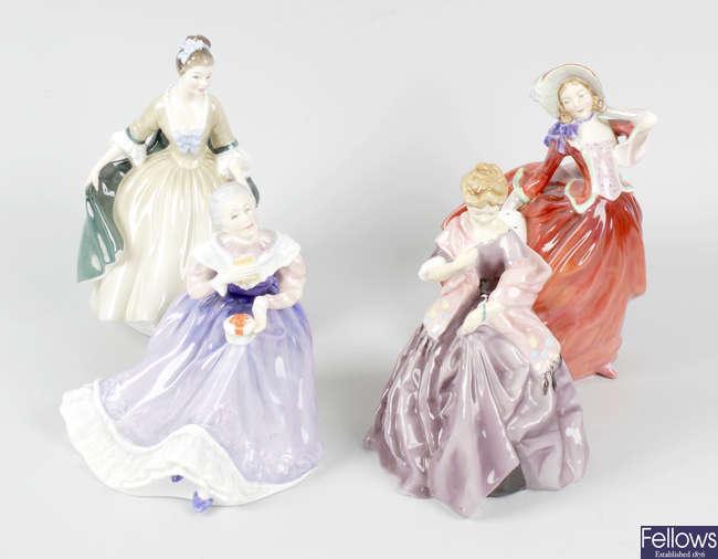 Three Royal Doulton figures, plus a Worcester figure.