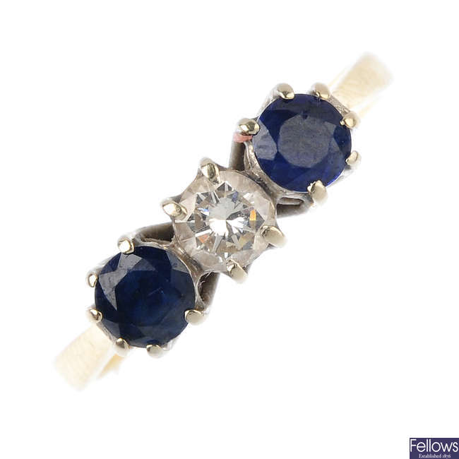 An 18ct gold diamond and sapphire three-stone ring.