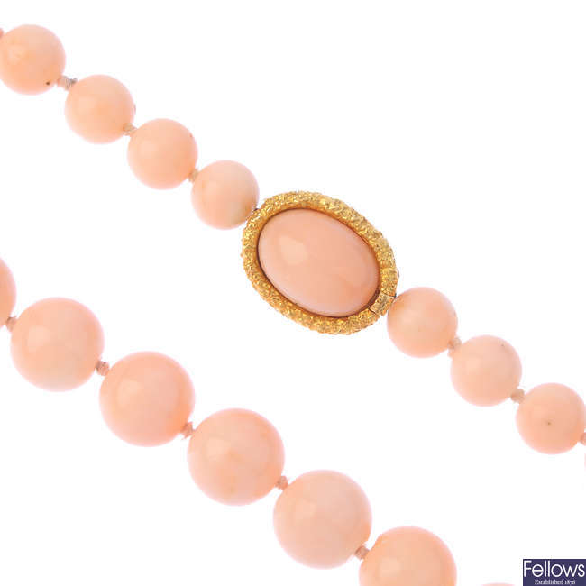 A coral single-strand necklace.