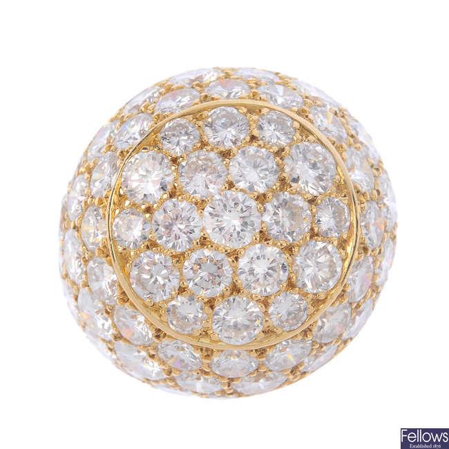 A diamond bombé ring.