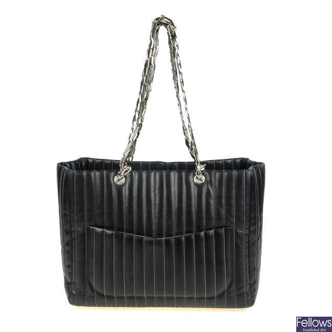 CHANEL - a vertical quilted large Madmoiselle handbag.