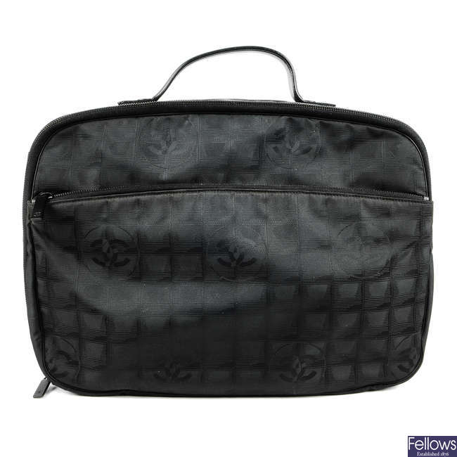 CHANEL - a small Travel Line carry case.