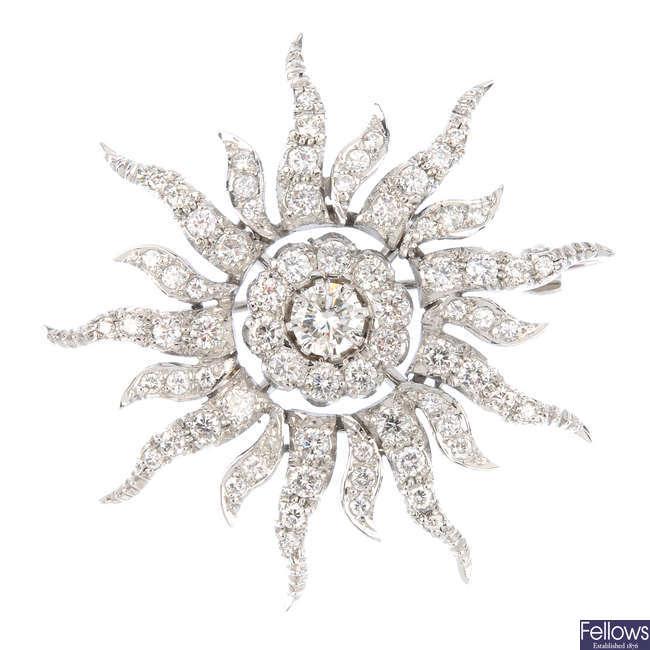 An 18ct gold diamond sun brooch.