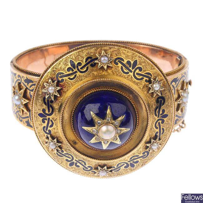 A late Victorian gold enamel, split pearl and diamond memorial bangle.