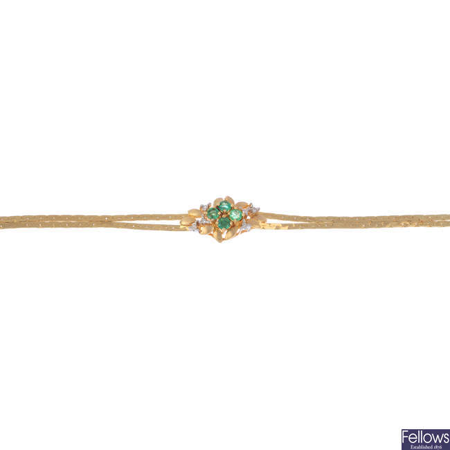 An emerald and diamond bracelet.