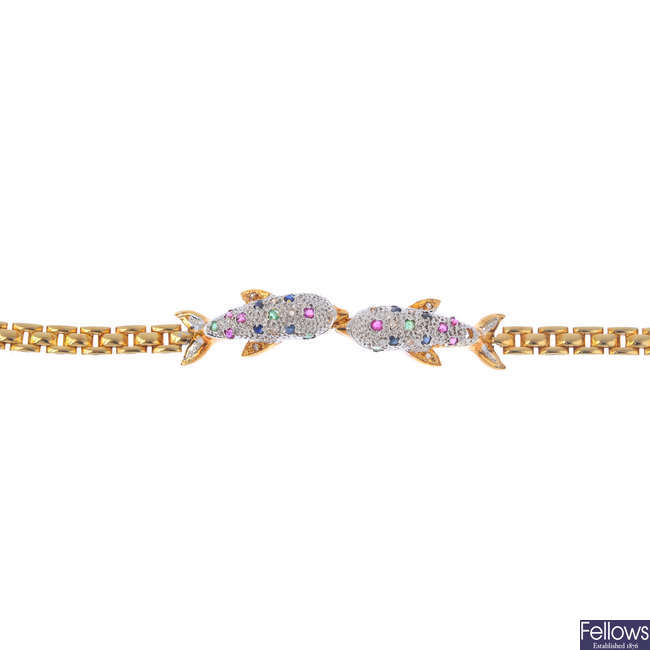An 18ct gold diamond, ruby, sapphire and emerald dolphin bracelet.